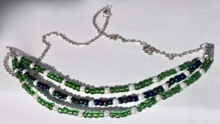 Three strand bead necklace.