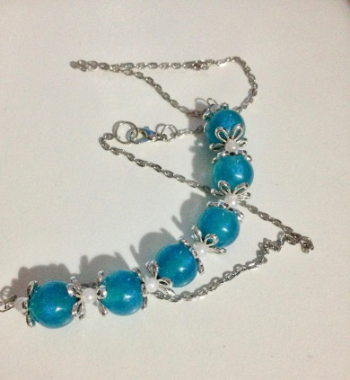 Blue resin beads, faux pearl beads with silver fixing $20.00