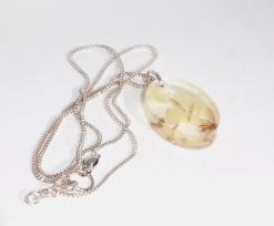 Yellow flowers in resin pendant