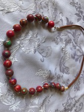 Red swirl beads $20.00 (glass beads, suede strap, 48cm