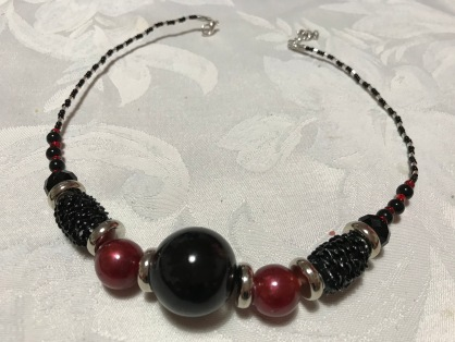 Black & red resin and glass beads, $30.00. 42cm length