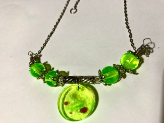 Green Resin Pendant & Bead Necklace $20.00: Iridescent lime green resin. Pendant 2cm high, green with red spots & swirls. Green resin beads steel spacers & chain. Length 55cm