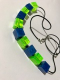 Green & Blue Square Bead Necklace $15.00:Green & Blue pearlised resin square beads (1cm), with square metal spacers on black strap (40cm)