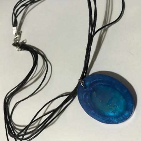 Blue Oval Resin Pendant $10.00: Blue pearlised resin pendant (Dark blue insert) 4x3cm, black 5 strand strap 42cm long